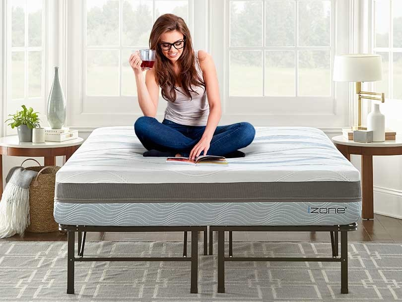 Young woman enjoying comfortable izone bed and platform bed frame set