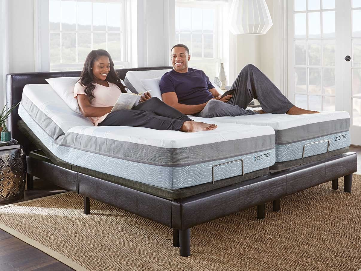 Happy couple enjoying the split king izone bed