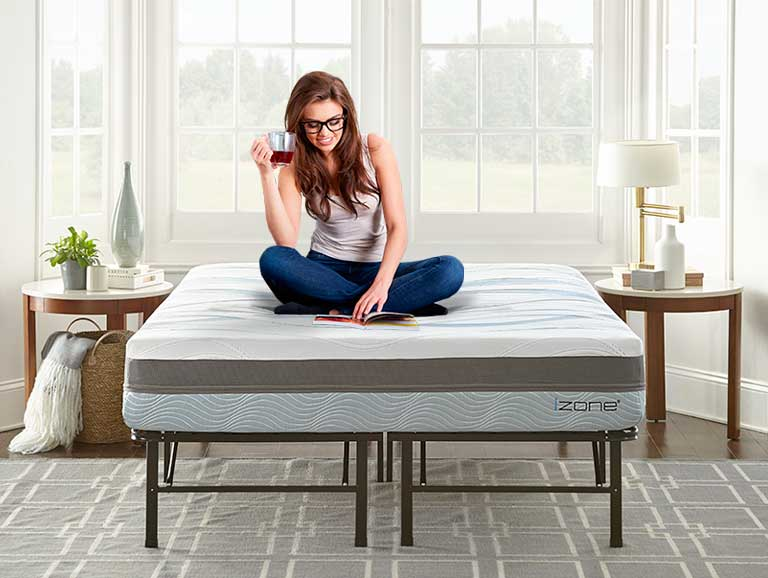 lifestyle image of girl enjoying her izone bed on a platform bed frame